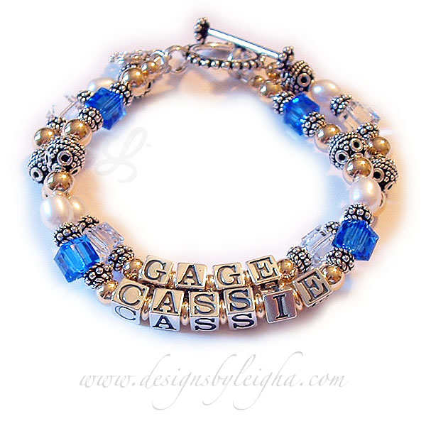 DBL-G8 - 2 string bracelet with 2 names  Enter: GAGE/Apr CASSIE/Sep The GAGE string is shown with April or Clear Swarovski Crystals. The CASSIE string is shown with September or Sapphire Swarovski crystals. This bracelet is shown with a Beaded Toggle Clasp.