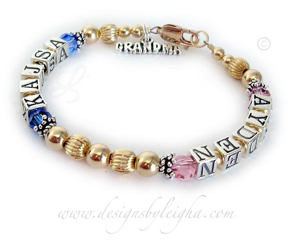 This is a 1 string / 2 name Gold Grandma Bracelet with AYDEN (October or Opal) and KAJSA (September or Sapphire). They also added 2 things to their order: 14k gold-plated lobster claw clasp and a GRANDMA charm.