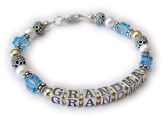 DBL-G8-1 string bracelet   Enter: GRANDMA/Mar This 1-string Grandma Gold Name Bracelet is shown with GRANDMA and March or Aquamarine Swarovski Crystals. They chose one of my beautiful free lobster claw clasps.