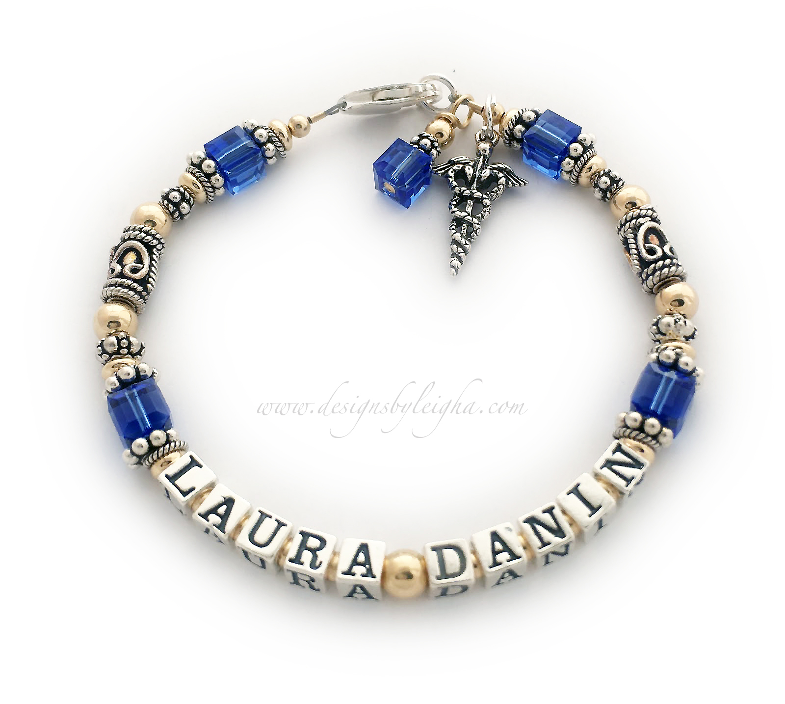 DBL-Message Bracelet 11-1string ENTER: LAURA DANIN/SEP  This bracelet has the name LAURA DANIN with a Medical Charm and September birthstone crystals and a September birthstone crystal dangle charm. Shown with a Lobster claw clasp.  Size: 7 1/2""