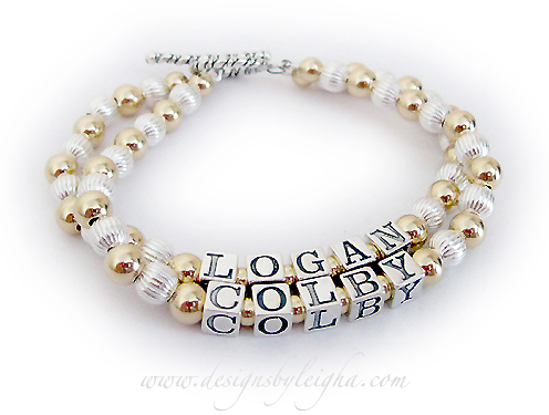 DBL-G1-2 string bracelet  Enter: LOGAN/COLBY (no crystals) This 2-string / 2 name Gold Mother Bracelet is shown with LOGAN and COLBY and no birthstone crystals (free) before and after the name. Shown with a Twisted Toggle clasp.