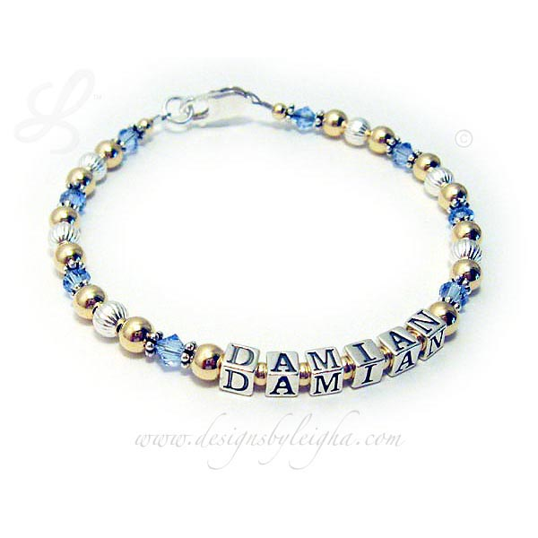 This Gold Mothers Birthstone Bracelet with Swarovski Crystals is a 1- string bracelet with 1 name: DAMIAN with December or Blue Topaz Swarovski Crystals. They picked the beautiful free lobster claw clasp I offer.