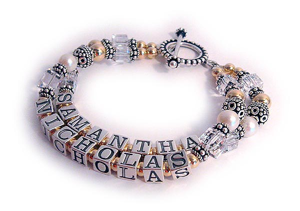 DBL-G8 - 2 string bracelet with 2 grandkids names.  Enter: SAMANTHA/Apr NICHOLAS/Apr Both the Samantha and Nicholas string have April or Clear Swarovski crystals. This bracelet is shown with a Beaded Toggle Clasp.