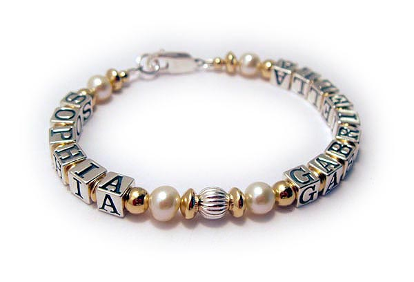 DBL-G9 - 1 string bracelet  Enter: SOPHIA GABRIELLA/no crystals Two names are shown on this 1-string Mommy Gold, Pearl and Bali Mother Bracelet. The kept the beautiful simple free lobster claw clasp.