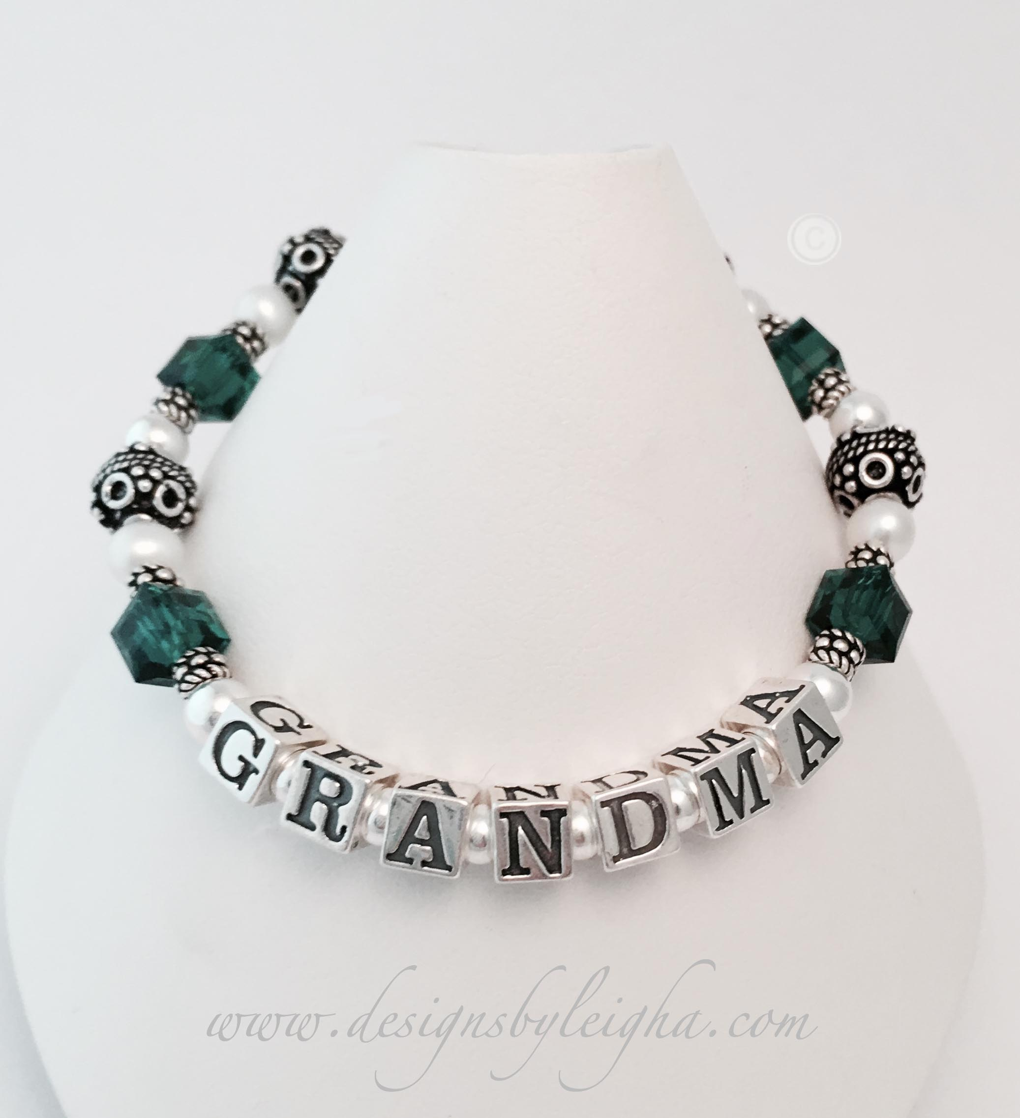 This is a 1-string Grandma Bracelet with 4 Emerald or May Swarovski Birthstones for her grandchild. You may have up to 6 different colors per string.