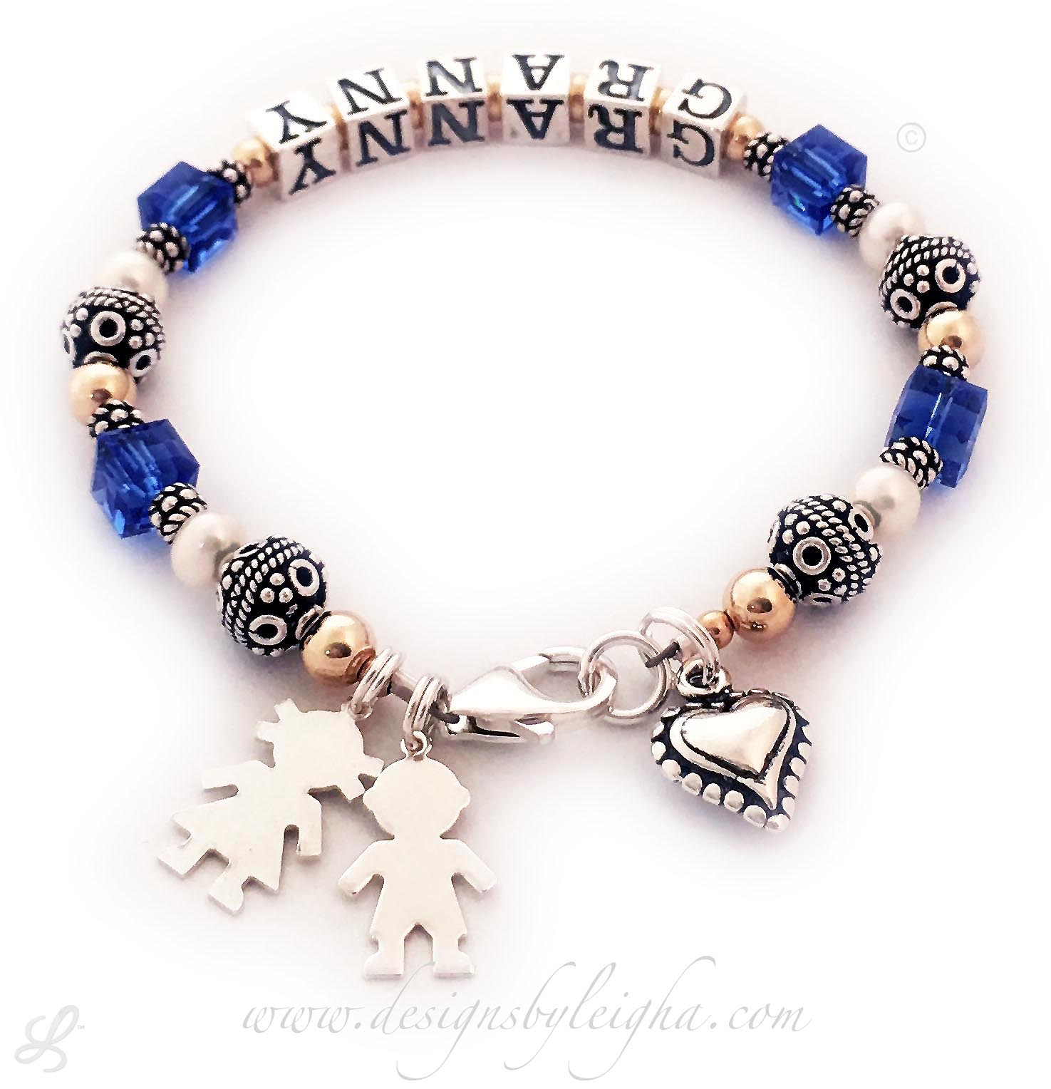This Grammy Bracelet is shown with GRANNY and September or Sapphire Swarovski Square Crystals and one of my free Sterling Silver Lobster Claw Clasp. You choose the name(s). They added 3 things to their order... A Boy Cutout Charm, Girl Cutout Charm and a Beaded Heart Charm.