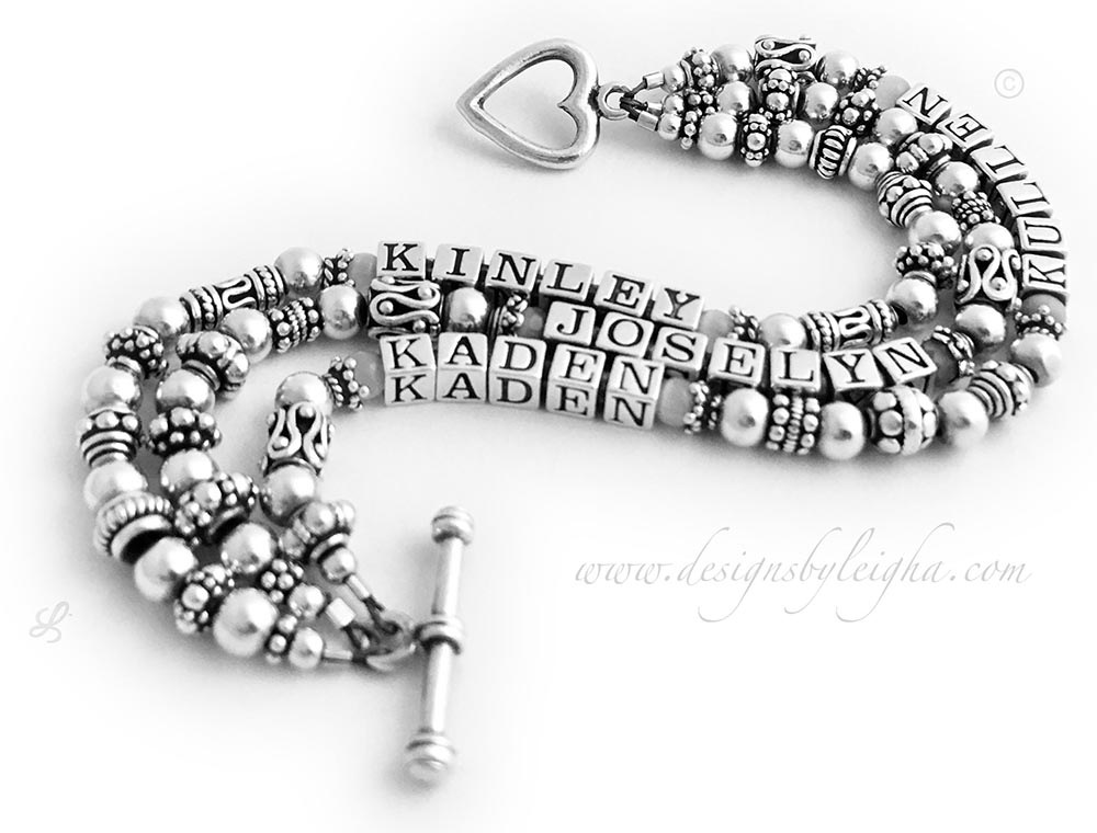 DBL-SS7-3	String Bracelet  Order: KINLEY, JOSELYN, KADEN KULLEN  They put 4 names on a 3 string sterling silver name bracelet and they added a Heart Toggle Clasp.