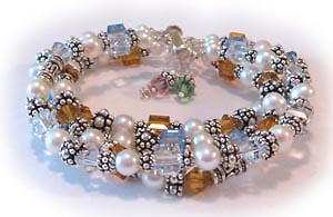 Swarovski Crystal and Pearl Mothers Bracelet - 3 string bracelet shown with birthstone crystals