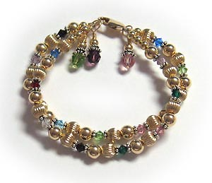 Gold grandmothers birthstone bracelet with Decemember birthstone crystals.
