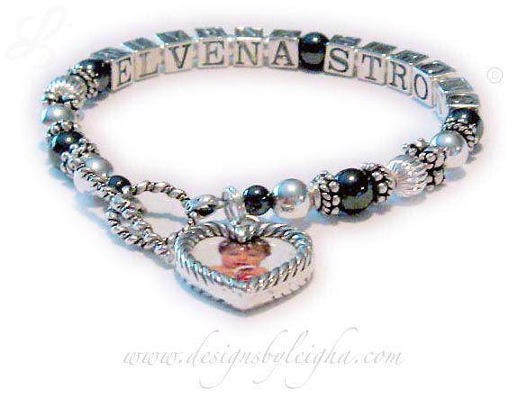 DBL-Hematite 4 - 1 string with 2 names  Enter: ELVENA STRONG  This Hematite and Bali Name Bracelet is shown with Elvena Strong on 1-string. They picked one of my free beautiful Twisted Toggle claps and added a Heart Picture Frame Charm. If you want me to insert the pictures for you please send them to me right after you place your order and then follow up with a text, email or call to be sure I have them. Thanks! Leigha