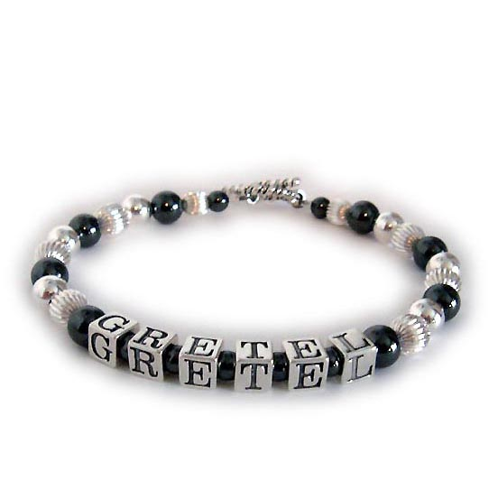 DBL-Hematite 2 - 1 string with 1 name  Enter: GRETEL  This Hematite and Sterling Silver Mother Bracelet is shown with a Twisted Toggle clasp with 1 name - Gretel.