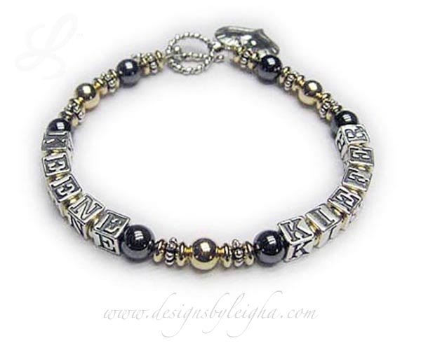 DBL-H3-1 string bracelet   Enter: KEENE - KIEFER This 1-string Hematite and Gold Mother Bracelet with 2 kids' names. They added a Heart within a Heart charm and picked one of my beautiful free Twisted Toggle clasps.