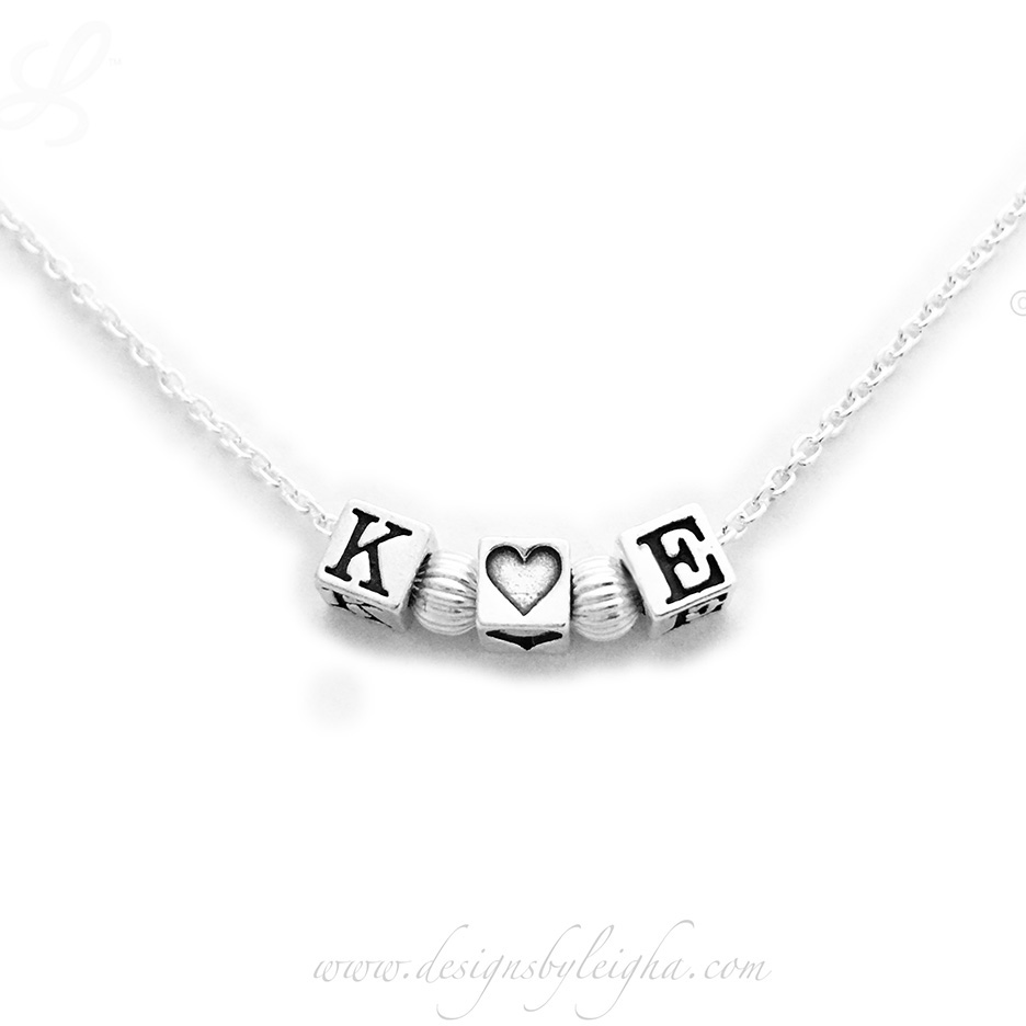 "This is a sweet necklace that says K Loves E. It is all sterling silver on an 18"" sterling silver rolo chain."