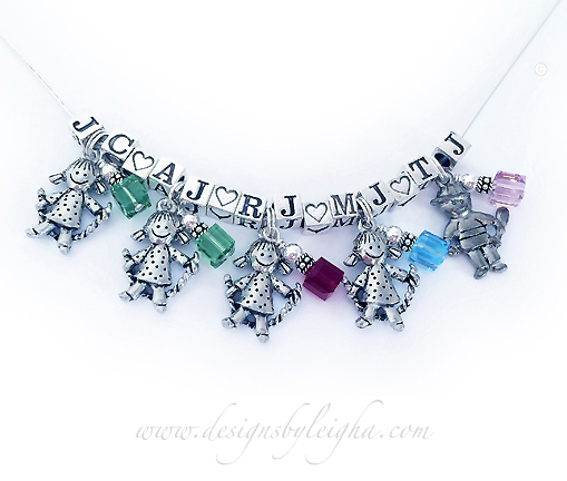 This Initial Necklace is shown with 5 sets of kid charms. Four Girl Charms, 1 Boy Charm, the kids' initials and Peridot/August, Ruby/July, Aquamarine/March and Pearl/June Birthstones are shown using 6mm Swarovski crystal cubes.