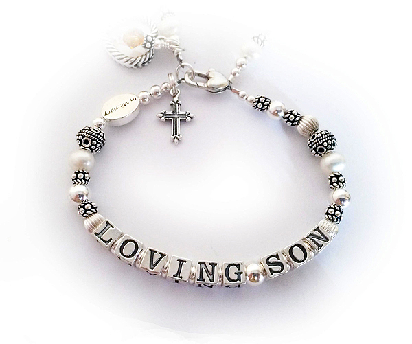 Loving Son (or Daughter) Bracelet  This is a 2-string bracelet with the name of the son on the second string. They added 4 add-ons; IN MEMORY bead, Heart Picture Frame Charm, Fancy Cross Charm,  November Birthstone Crystal Dangle and a Heart Lobster Claw Clasp.