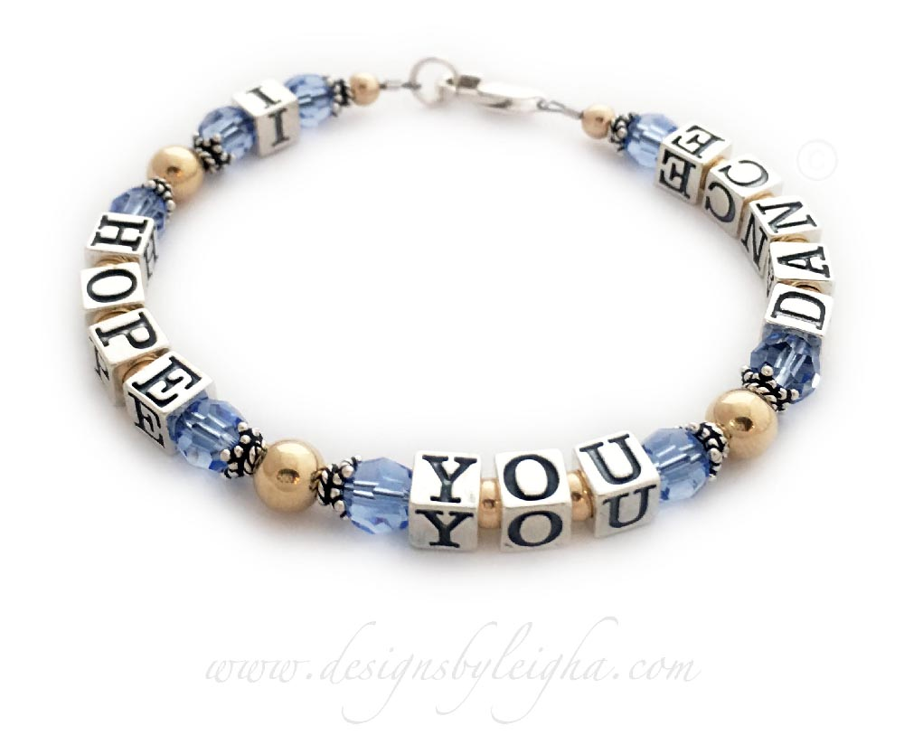 Blue Topaz and Gold I Hope You Dance Bracelet with a lobster claw clasp