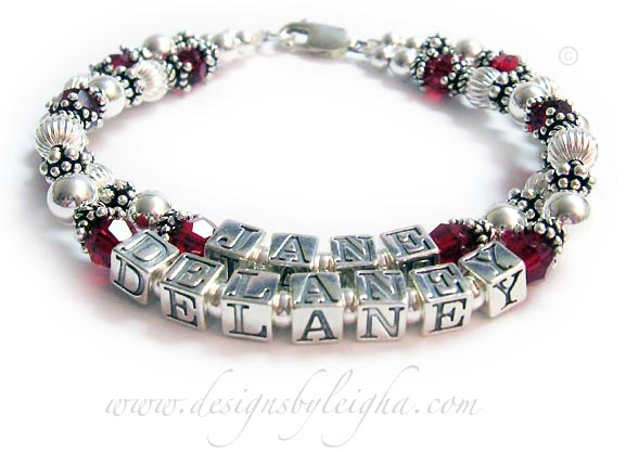 DBL C5-2 Names: JANE & DELANEY Crystals: July/Red  Shown with a lobster claw clasp.  All sterling silver and Swarovski crystals.  Block letters: 5.5mm