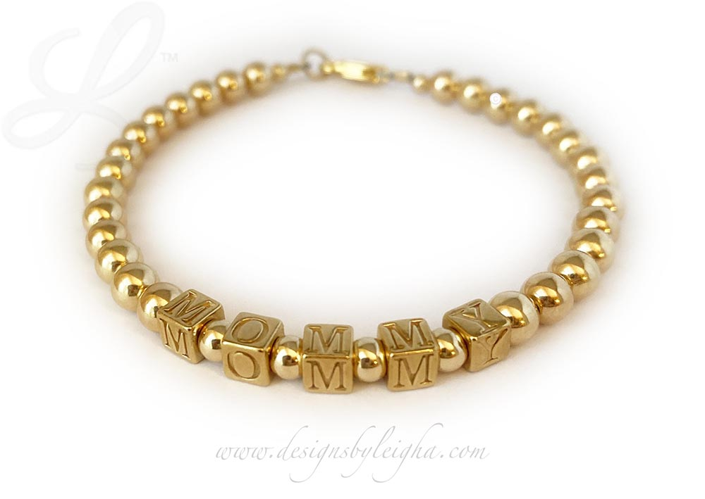 "Gold Block Mothers Bracelet with Mommy This beautiful bracelet has ""MOMMY"" on it."