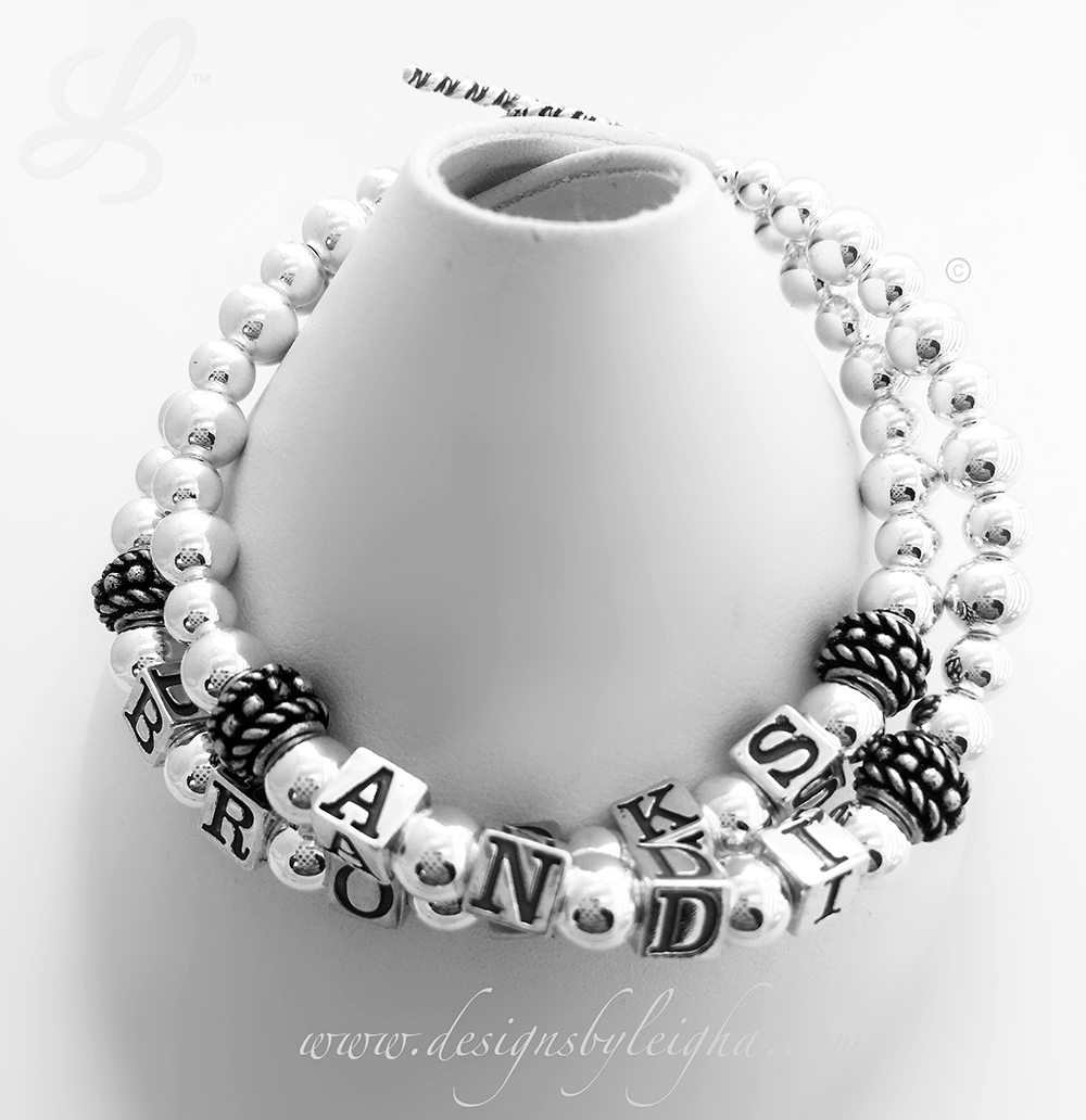 DBL-SS2-2 String Bracelet  This is a 2 string Mother's Bracelet with 2 names (no crystals) and a Twisted Toggle Clasp. Andi & Brooks