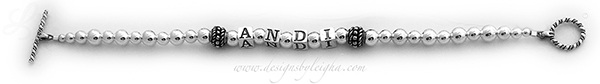 DBL-SS2-1 String Bracelet  This is a 1 string Mother's Bracelet with 1 name (no crystals) and a Twisted Toggle Clasp. Andi