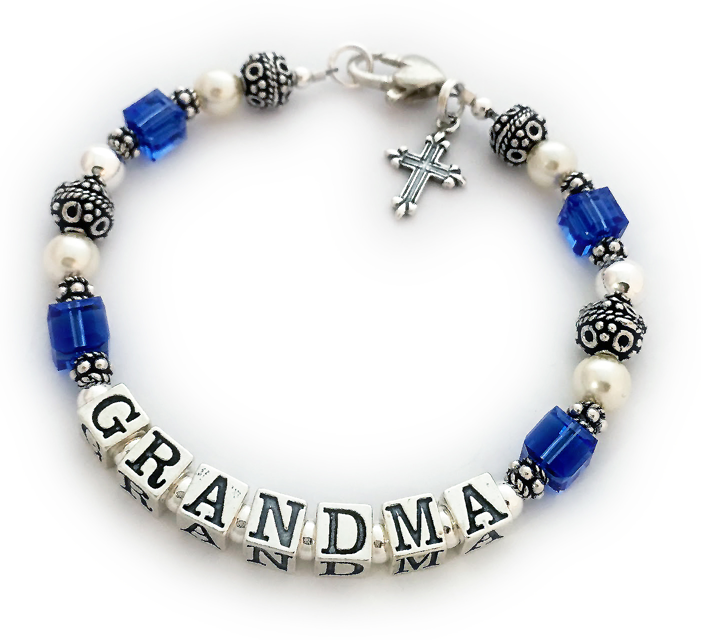 DBL-SS6-1	String Bracelet  Enter: GRANDMA/Sep  Grandma birthstone bracelet shown with an upgraded Heart Lobster clasp and they added a Fancy Cross charm. They picked Sapphire or September Birthstone cyrstals by Swarovski.