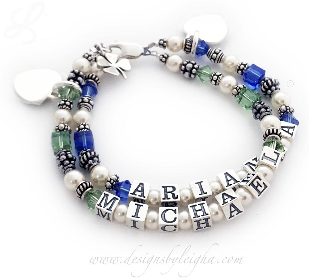 DBL-C9-2	String Bracelet  Order: Arianna/Sep - Michael/Aug and add 3 charms: Shamrock Charm and 2-Initial Heart Charms. This is a 2-string Birthstone Mother Bracelet with Arianna and September or Sapphire Birthstones and Michael and Peridot or August Birthstones. They also added a Shamrock charm and 2 Initial Charms.