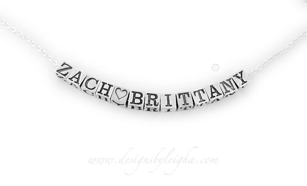 "This is a sweet necklace that Zach gave to Brittany. It says, ""Zach Loves Brittany"". It is all sterling silver on an 18"" sterling silver rolo chain."