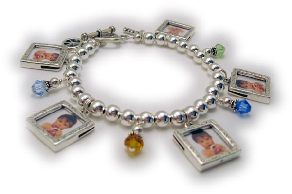 Shown with 5 picture frame charms, 4 birthstones crystal dangles,  a Grandma charm (hard to see) and a Peace charm (hard to see)