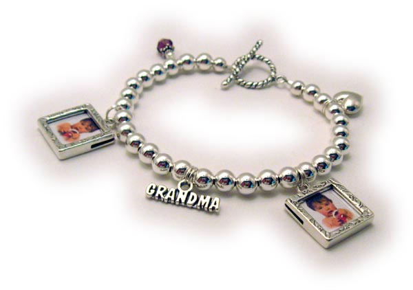 Grandma Charm Bracelet shown with 2 picture frame charms, Grandma charm, puffed heart, February Birthstone Crystal Dangle and a toggle clasp.