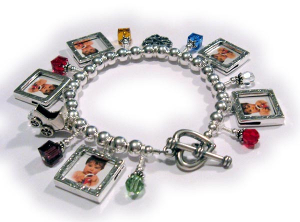Love Charm Bracelet Shown with a love charm. baby carriage charm, 7 birthstone crystal dangles and 5 picture frame charms (Square Textured Picture Frames)They also added a Heavy Heart Toggle Clas to their order.