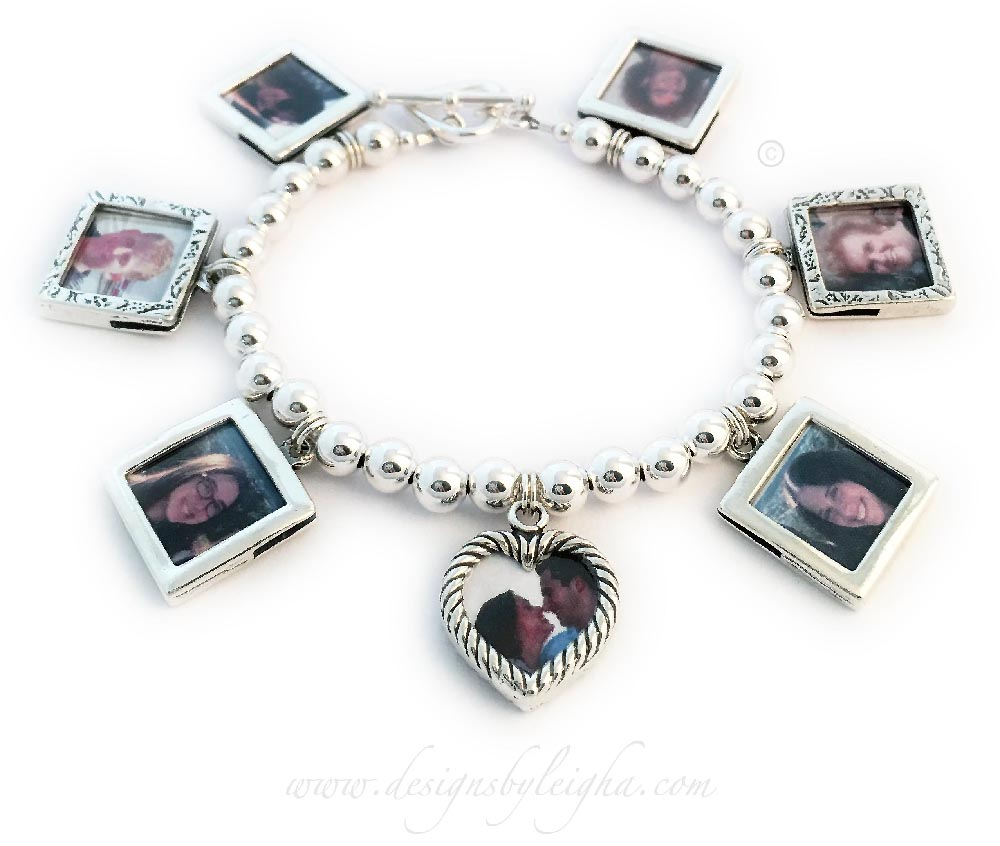 This sterling silver picture frame charm bracelet is shown with 7 charms: 5 Sterling Silver Square Textured Charms are included in the price. They switched out 3 textured square frames for 3 smooth square frames and added 2 additional picture frame charms to their order. Each charm holds 2 pictures (front and back). If you email me the pictures I will insert them for you or you can do it yourself. You just need to cut the picture down to size and insert it in the top then press it closed with your fingers. They also upgraded the free toggle clasp to a Heart Toggle clasp.