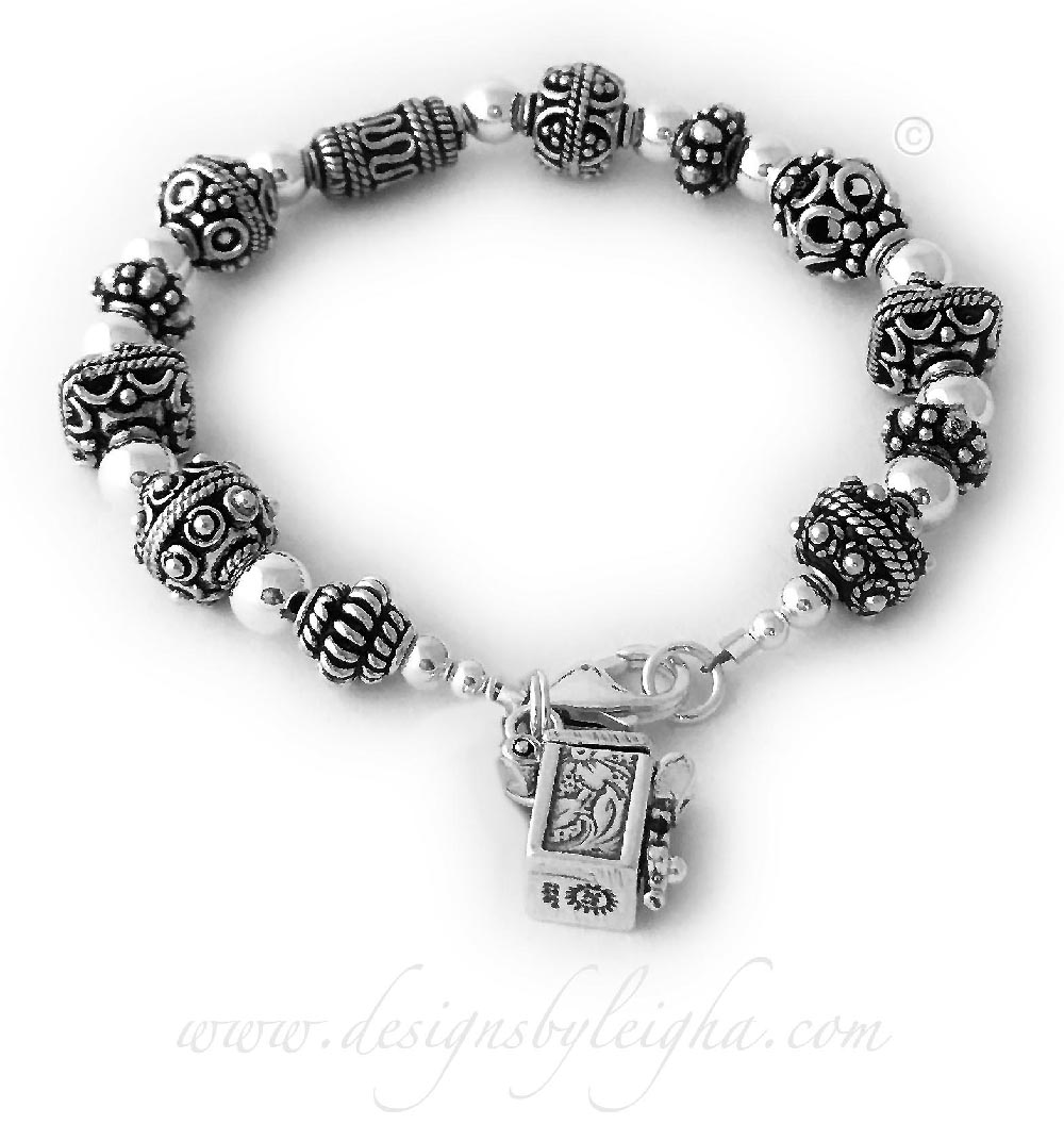 This Message Box Bracelet is shown a Message Box charm. The Message Box charm is included in the price.