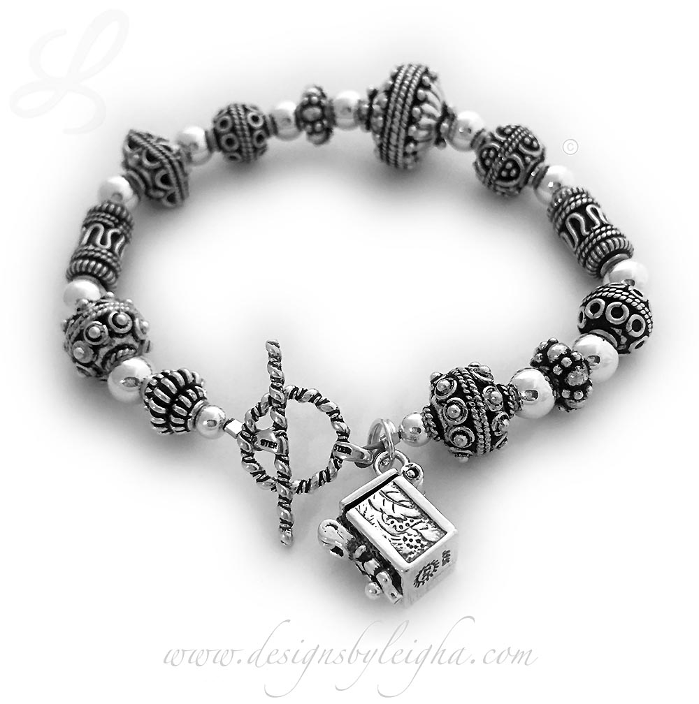 Blessing Box Bracelet with a Blessing Box Charm you can open up and slip a prayer inside.