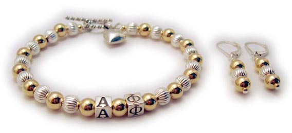 Gold and Sterling Silver Alpha Phi Bracelet with a Puffed Heart Charm shown with coordinating earrings