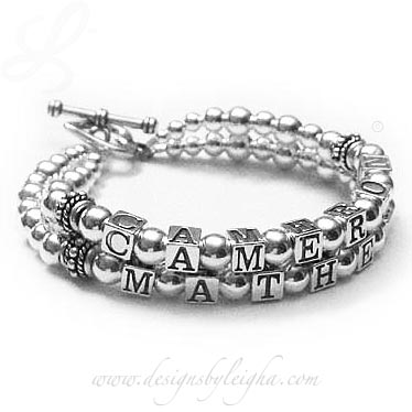 DBL-SS2-2	String Bracelet Cameron and Mathew bold and beautiful 2-string mothers bracelet with an upgraded Heart Toggle Clasp.
