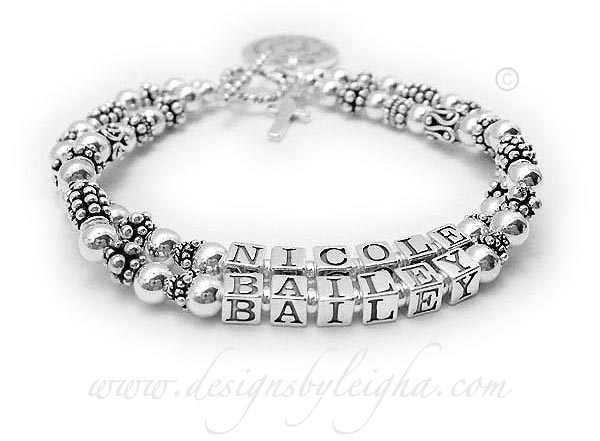DBL-SS7-2	String Bracelet Nicole/no crystals & Bailey/no crystals. They added a Simple Cross Charm and a Sayings Charm and they picked a simple toggle clasp.