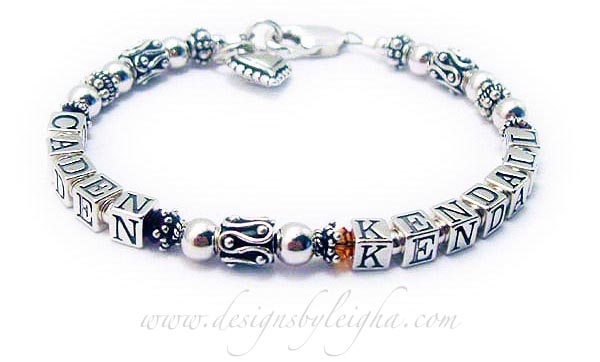 DBL-SS7-1	String Bracelet This is a 1-string bracelet with 2 names. Order: CADEN/Jan & KENDALL/Nov with a lobster claw clasp. They added a Beaded Heart Charm.