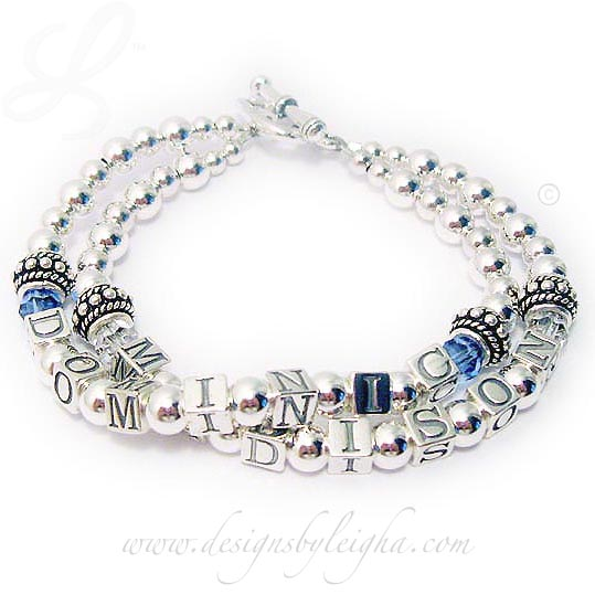 DBL-SS2-2 string bracelet This DOMINIC and MADISON bracelet is shown with free Birthstone Swarovski crystals before and after the kids' names and they upgraded to a Heart Toggle Clasp.