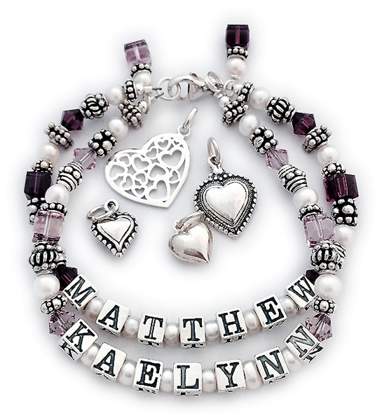 DBL-SS5-2	String Bracelet Order: MATTHEW/Feb - KAELYNN/Jun and add 2 birthstone crystal dangles. This is a 2-string Mother Bracelet with Matthew and Kaelynn and their birthstones. If you perfer an all sterling bracelet order: MATTHEW/no crystals - KAELYNN/no crystals.