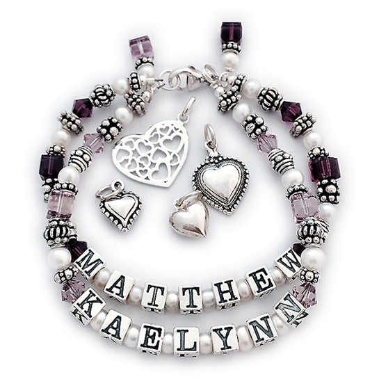 DBL-SS5-2 String Pearl Name Bracelet Order: MATTHEW/Feb - KAELYNN/Jun and add 2 birthstone crystal dangles. This is a 2-string Mother Bracelet with Matthew and Kaelynn and their birthstones. If you perfer an all sterling bracelet order: MATTHEW/no crystals - KAELYNN/no crystals.