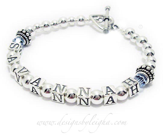 The Sterling Silver Birthstone Name Bracelet is shown with SAVANNAH and they added the free Aquarmarine or March Birthstone Swarovski crystals before and after Savannah and they picked the Heart Toggle Clasp.