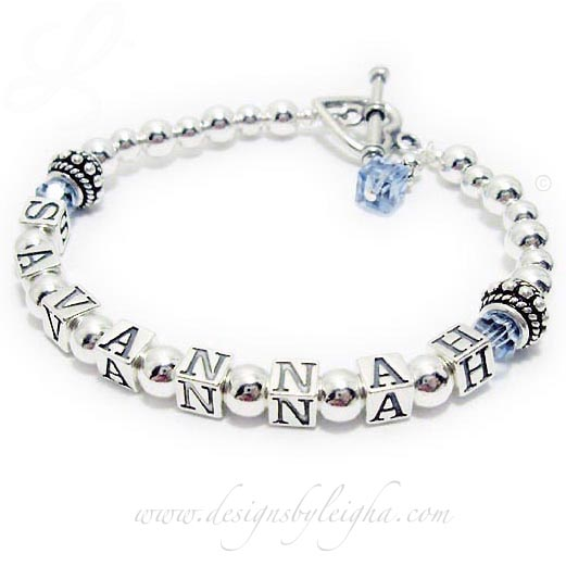 The Sterling Silver Birthstone Name Bracelet is shown with SAVANNAH and they added the free Aquarmarine or March Birthstone Swarovski crystals before and after Savannah and they picked the Heart Toggle Clasp. They also added 1 add-on: A Aquarmarine or March Birthstone Crystal Dangle