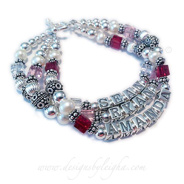 DBL-SS6-3	String Bracelet This is a 3-string bracelet with 3 names: SEAN with April or Diamond Crystals, RYAN with pink or October Birthstone Crystals and AMANDA with July or Ruby Crystals.
