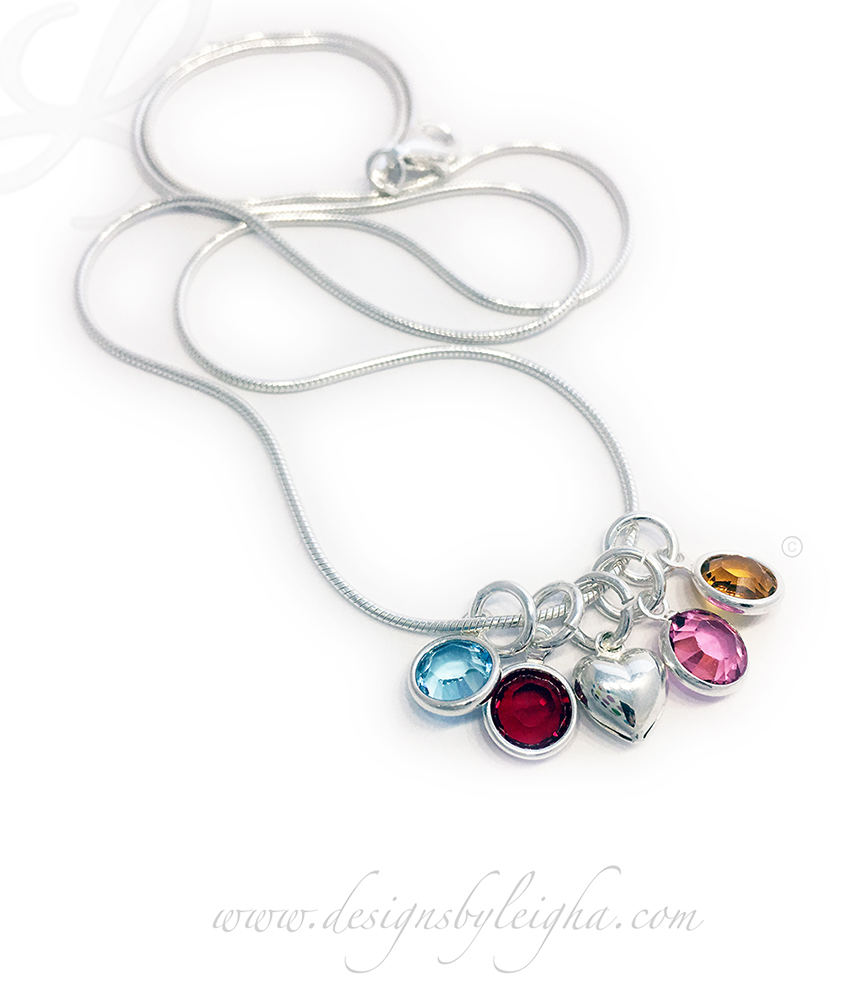 Swarovski Crystal Channel Birthstone Necklace shown with 4 birthstone charms and a Tiny Heart Charm - March (Aquamarine), January (Garnet) - Heart Charm - October (Opal) and November (Golden Topaz). You can add additional charms yourself, in the future with this snake chain.