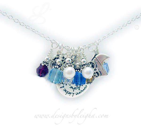 Swarovski Crystal Channel Birthstone Necklace shown with lots of square, round and bicone Swarovski crystals and pearls and a few sterling silver charms. JBL-CC-N3