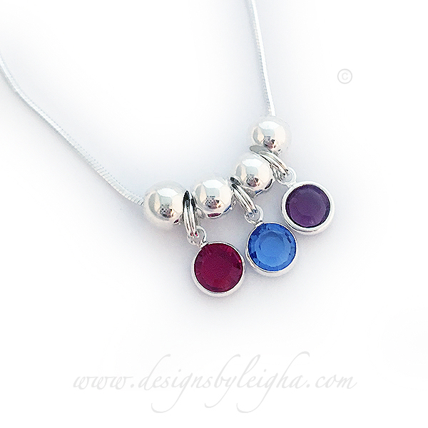 Swarovski Crystal Channel Birthstone Necklace shown with 3 birthstone charms - January, September, February