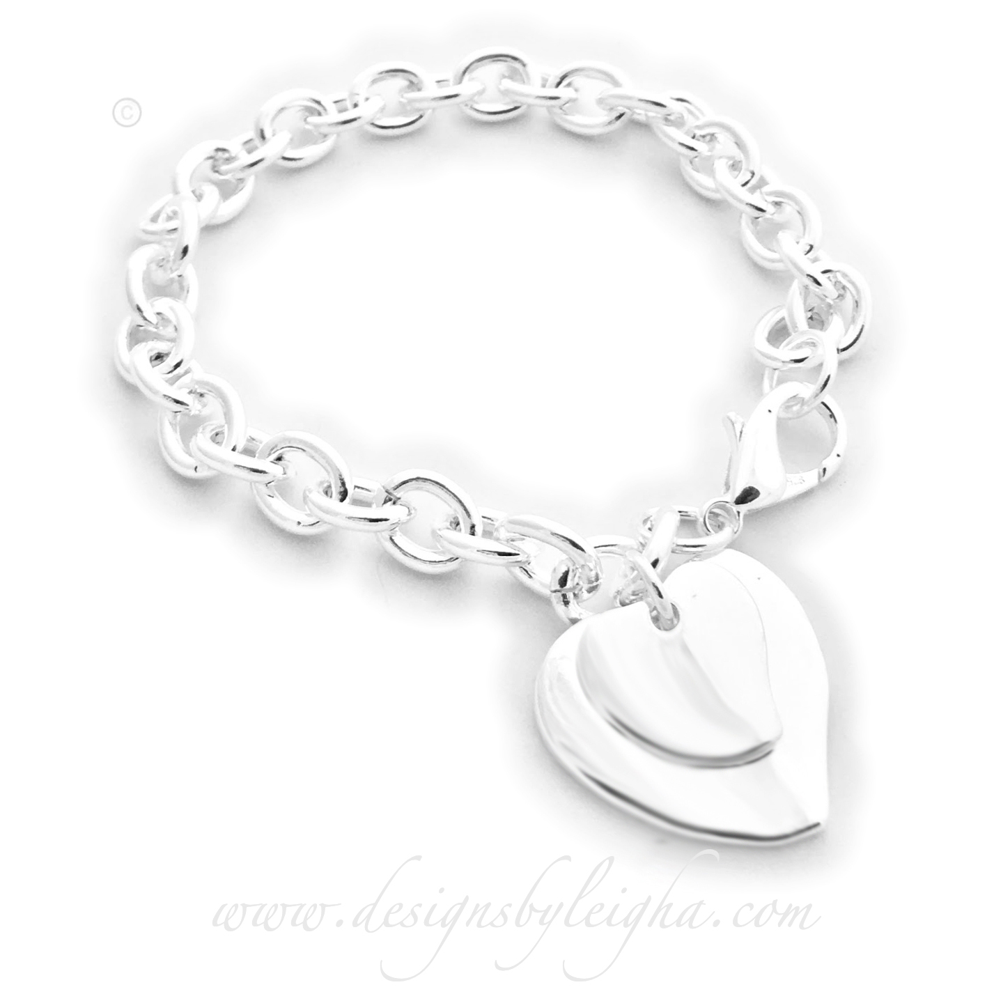 Thick silver chain charm bracelet with 2 heart charms and a lobster clasp.