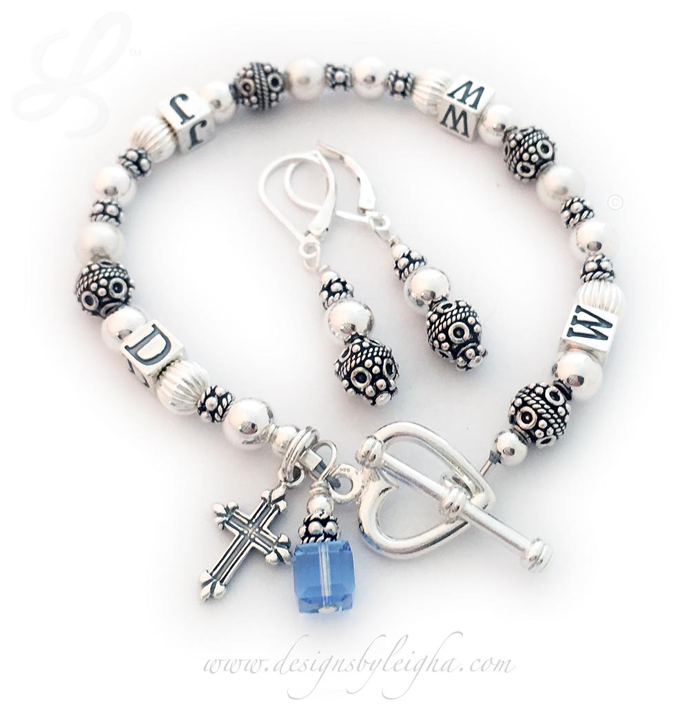 DBL-WWJD-1S  What Would Jesus Do Bracelet is shown with 4 add-ons: They added a Fancy Cross Charm, a December or Blue Topaz Birthstone Crystal Charm and upgraded to a Heart Toggle Clasp and added Earings to their order. Size: 7""